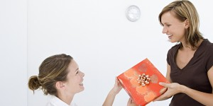 Woman giving colleague a gift