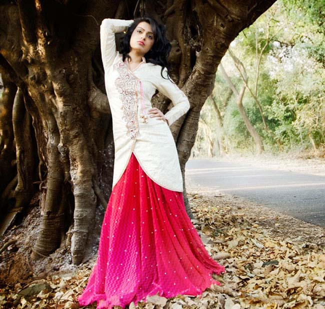 Magenta colored lehenga with a cream coat style choli...styloplanet.com