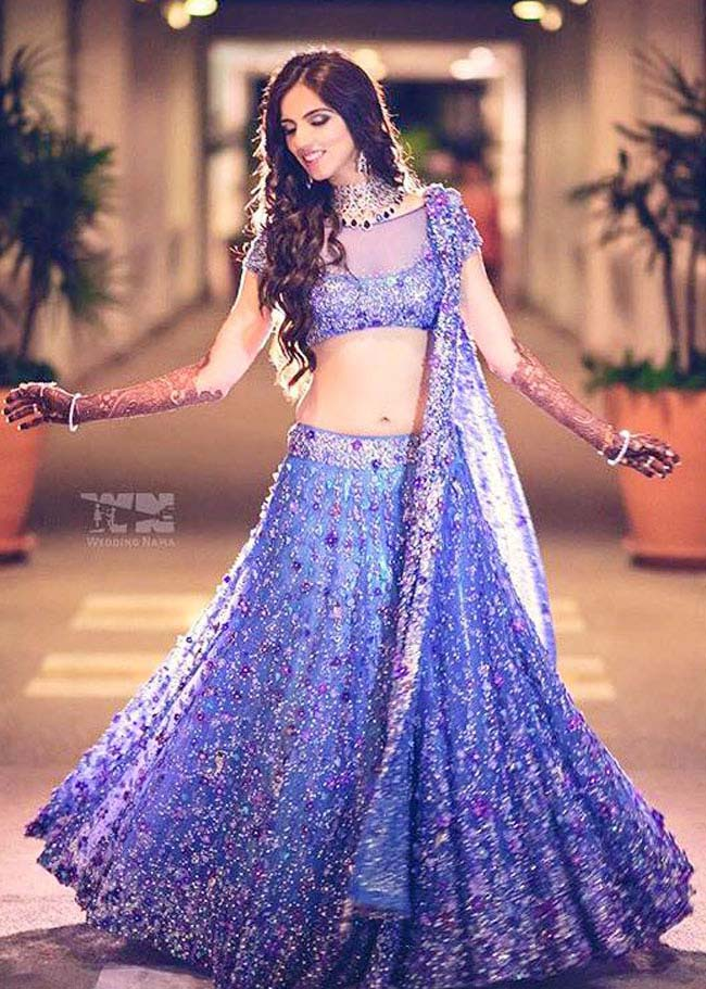 Nishka Lulla in her mother Neeta Lulla designed purple lehenga...styloplanet.com