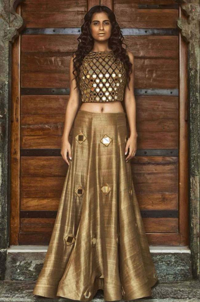 Stylish golden lehenga with a heavy mirror work choli...styloplanet.com