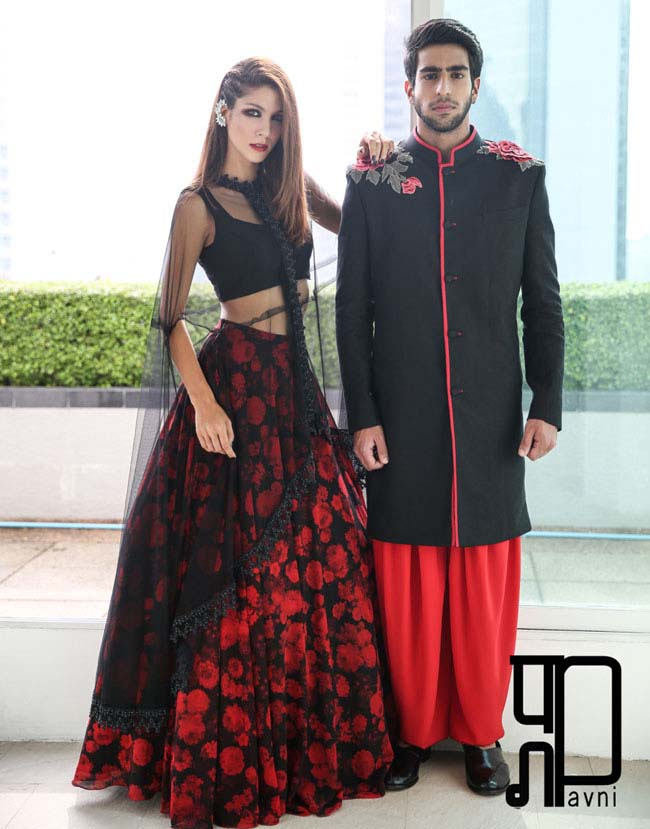 Black And Red floral print lehenga with net cape and a crop top...styloplanet.com