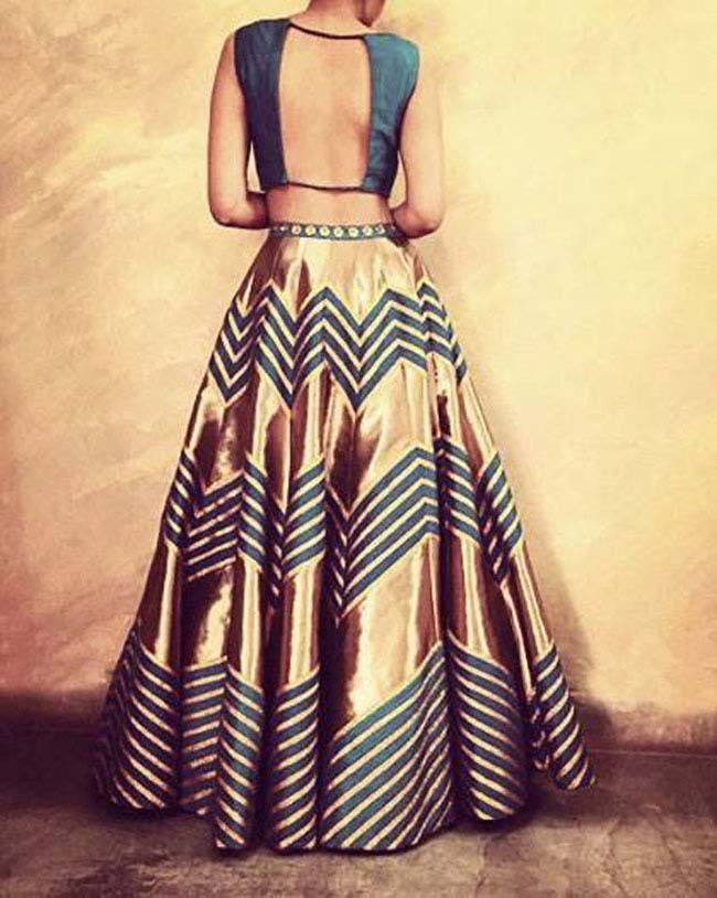 Gold and teal color lehenga with back open choli style...styloplanet.com