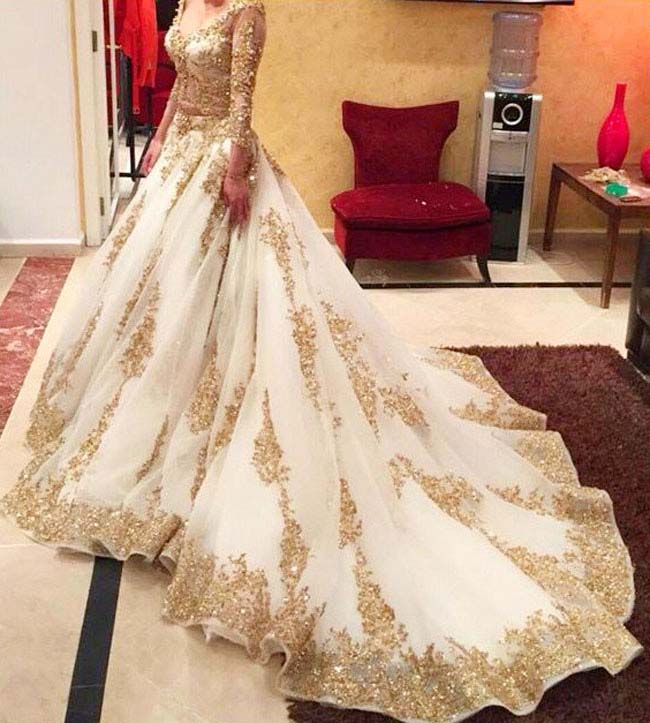 Majestic golden and cream bridal lehenga...styloplanet.com